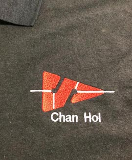 Embroidered Custom Cave Arrow on a Polo Shirt